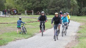 A group of cyclists on the trail near Victoria Battery, Waikino