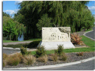 Gilmour Lake entrance featuring a Hinuera stone sculpture by Trevor Heighway